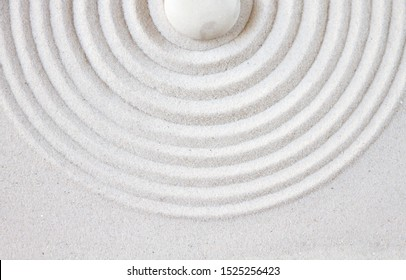 White stone in the sand. Zen japanese garden background top vue