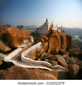 White stone stair leading to the temple of Hanuman on the rock.