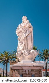 "White stone statue of the Virgin Mary a monumnet to the immaculate conception ""Monumento a la Inmaculada Concepción"" in Laguna Square, Plaza de Laguna, Ayamone, Spain"