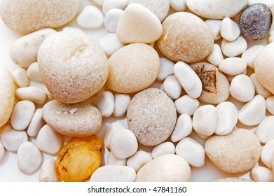 white stones and pebbles background.