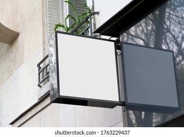 White store brand sign board mockup. Empty squared shop frontage in street