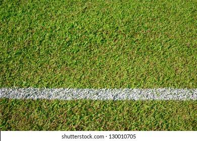 White stripe line on the green grass field