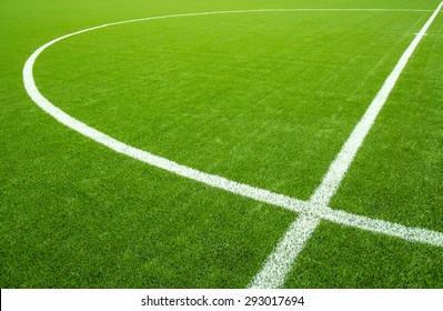 White stripe on the artificial green soccer field from top view