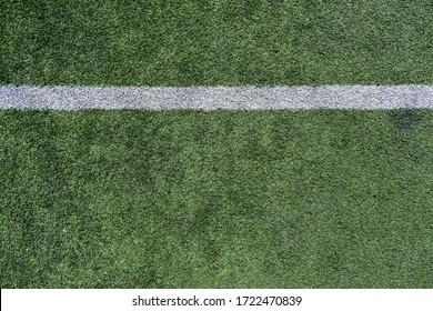 White stripe on a bright green artificial grass soccer field