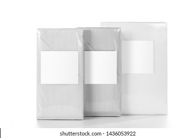 White striped fabric bedlinen items in the PVC retail pack with empty label isolated. Photo ready for mock up.