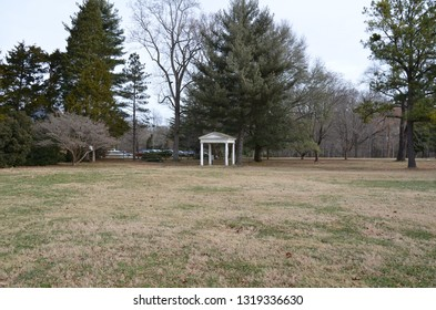 white structure with columns in grass