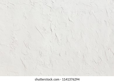 white structured plaster wall as harmonic background