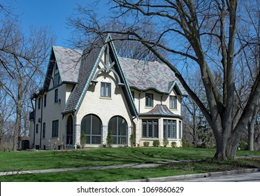 White Stucco Gothic Revival House with Blue Accents
