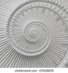 White stucco moulding plasterwork spiral abstract fractal pattern background. Plaster abstract spiral effect background. White gypsum abstract background. Decorative stucco repetitive element concept