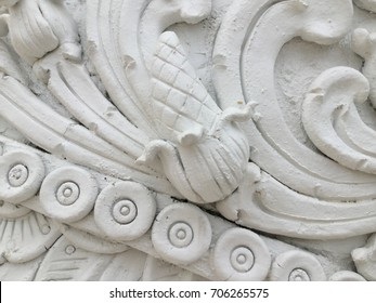 White stucco moulding plasterwork spiral abstract fractal pattern background. Plaster abstract spiral effect background. White spiral abstract background. Decorative stucco element concept fractal