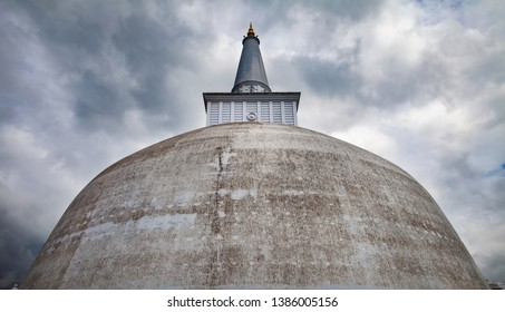 White stupa, known as Ruwanwelisaya stupa in Anuradhapura sity. This 140-BCE stupa is an ancient, sacred Buddhist site & reaches a height of 338 ft.