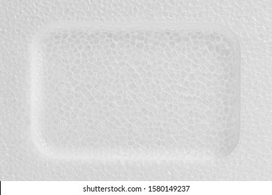 White Styrofoam with deepening within close up. Texture and background with copy space