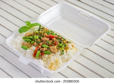 White styrofoam lunch boxes containing and rice