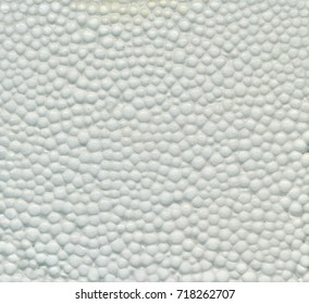 White Styrofoam Texture. White styrofoam balls background. Close shot. Safe packaging for fragile items. Detailed background of white styrofoam material