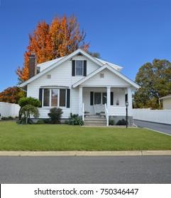 White Suburban Bungalow home blue sky USA