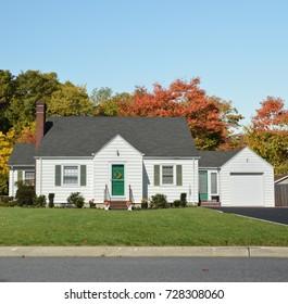 White Suburban Cap Code style home Autumn season blue sky USA
