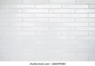 White subway tile background with rectangular bricks.