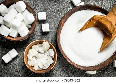 White sugar in bowls. On a rustic background.