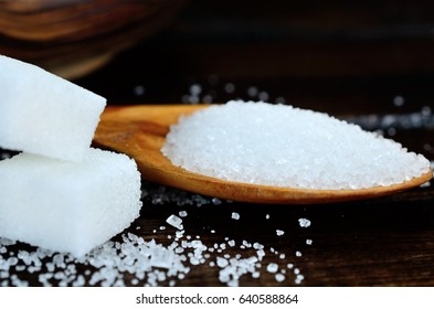 white sugar cube on wooden table