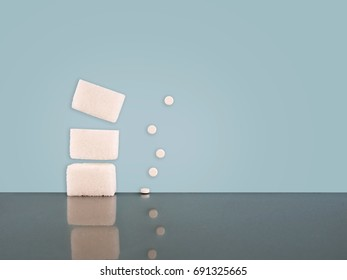 White sugar cubes and aspartame, low calorie alternative sweetener. With reflections and copy space. Diet issue.