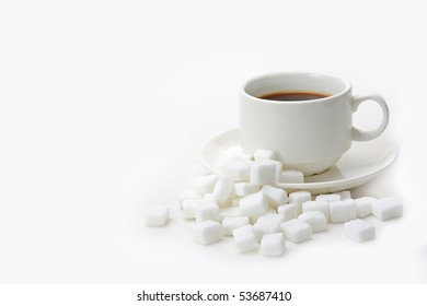 White sugar cubes and coffee isolated on white background