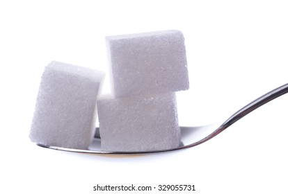 White sugar cubes on a spoon, isolated on white