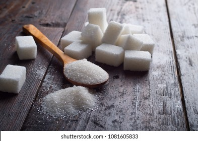 white sugar on wood table