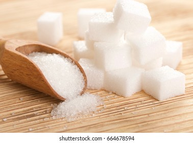 white sugar on wooden background