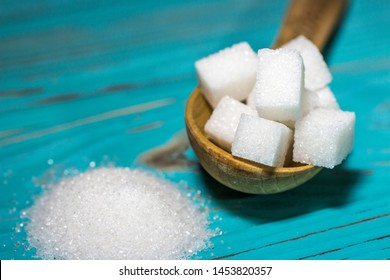 White sugar refined and crystallized on a blue background.