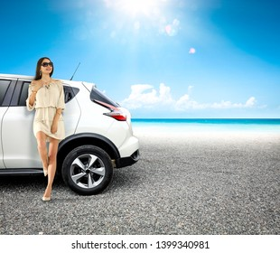 White summer car on beach and free space for your decoration. Sunny warm day and sun light.