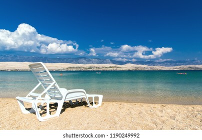 White sun bed on beautiful beach of Croatia, Adriatic Sea
