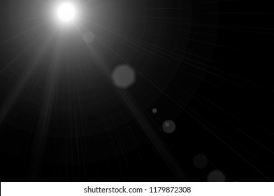 White sunlight is isolated on a black background with lens flare effect for overlay design or screen blending mode