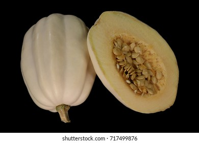 White Swan Squash outside and inside view over black background. Inside squash are seeds and light yellow flesh sweet when cooked outside is white colored shell. Later summer to middle winter Fruit