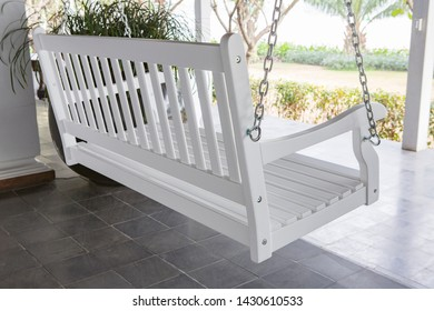The white swing chair in the backyard.