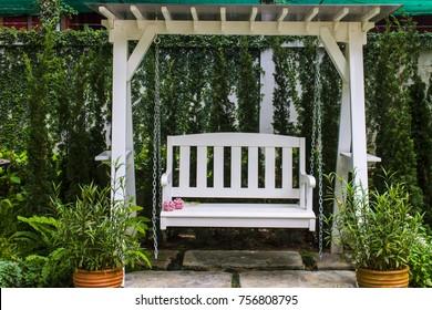 white swing in the garden