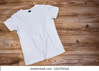 white t shirt mockup empty front side template on wood background for textile and fashion designer