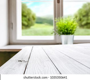 White table background of free space for your decoration and spring window with green plant .