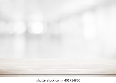 White table background over blur bokeh light for product display, White wood desk, counter, shelf surface backdrop, Empty wooden table top over blur kitchen room background for food banner, template