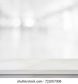 White table background, Product shelf and blur kitchen background, White marble table top, desk, counter over blur perspective restaurant with bokeh light for food and product display backdrop