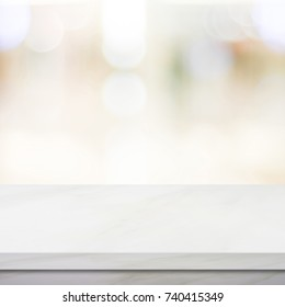 White table and blur kitchen background, Empty white marble counter, shelf, table top over blur store, shop with abstract bokeh light background, Product and food display desk banner, mockup, template