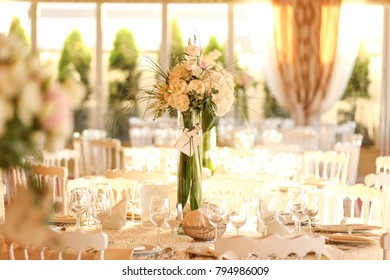 white table with bouquet of flowers in top