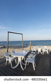White Table and chair front off beach