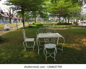 white table and chairs in the garden