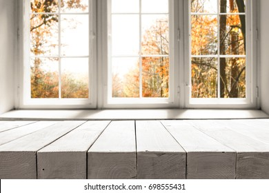 White table on the background of a white autumn afternoon window