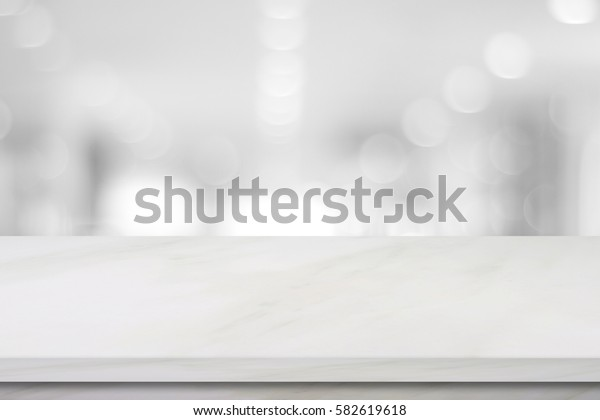 White table top, counter perspective background, Empty white marble shelf, desk over blur store, shop background, Stone table for product display, Luxury tabletop and blur kitchen for food banner