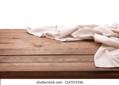 White tablecloth on wooden table isolated. Napkin close up top view mock up for design.