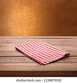 White tablecloth on wooden table. Napkin close up top view mock up for design.