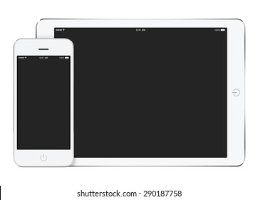 White tablet computer in landscape orientation and smartphone in portrait orientation template for adaptive design presentation. High quality. Isolated on white background.
