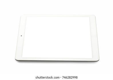 White tablet computer on over white background