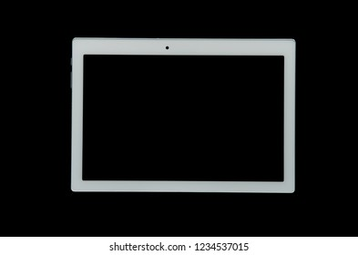 White tablet isolated on a black background. Topview.